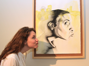 Richland College student Genn Armstrong poses with her painting, Untitled (self-portrait).