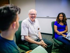 Photo of John Millemon with educators