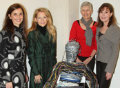 North Lake art student Joelma Regis, left, and her sculpture with Lynn McBee, Rebecca Young and Gay Solomon.