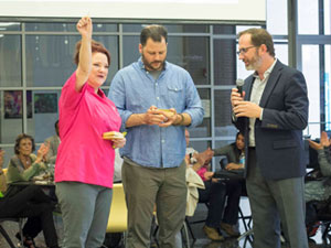 Janice-Provost and Chad Houser presented with pins by Steve DeShazo at Bits Bites